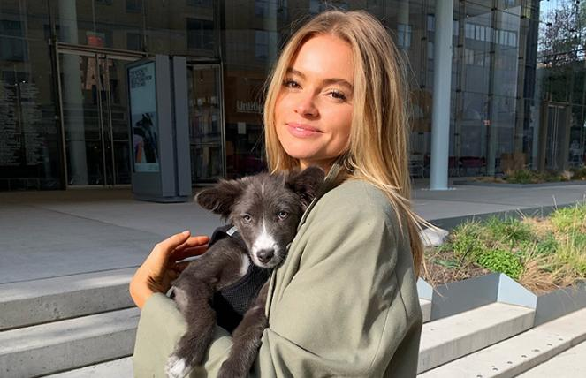 Claire Rose holding Billie, the puppy she adopted