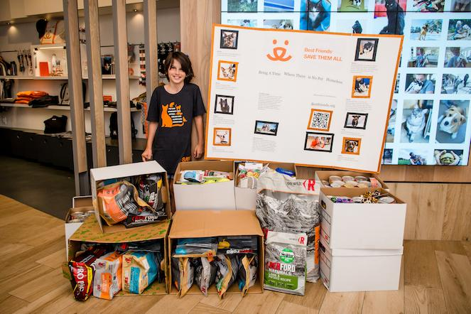 Melodie at the Pet Adoption Center with her donations