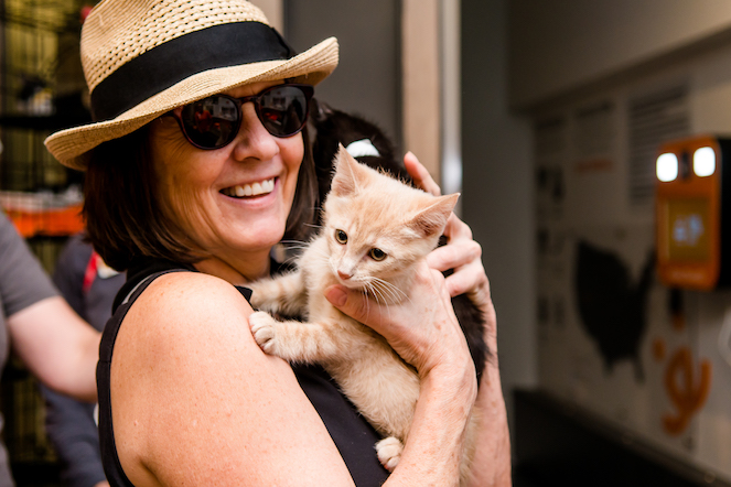 Woman holding her adopted kitten