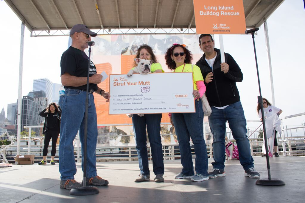 Strut Your Mutt check being presented to Long Island Bulldog Rescue